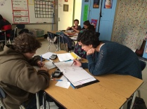 Algebra students work together to solve math problems!