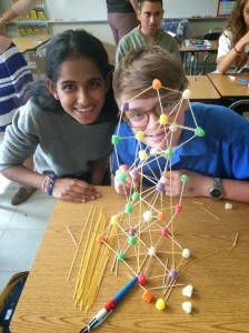 Eggy and Priya are very proud of their wonky tower