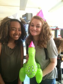 Mheri and Katie have made origami hats, one for Mr. Dino, too!