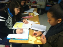 Students work together to make math matches!