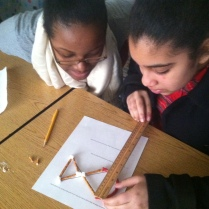 Ashley and Tatiana measure shapes made from pretzles and marshmallows!